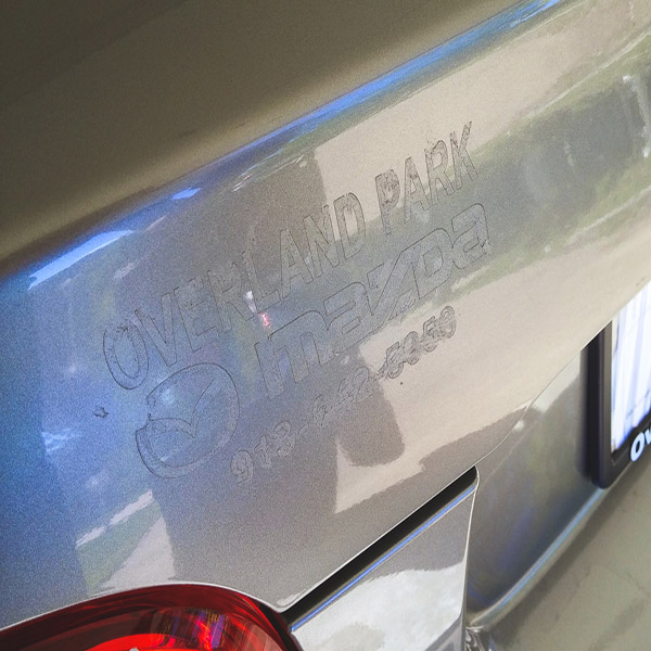Best way to remove a car dealer sticker, and a decal that has been stuck
